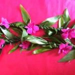 Maile Style Ti Leaf Lei: $55. Add orchids for $5.00.