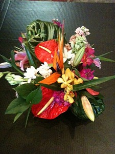 Bright tropical centerpiece: roses, dahlias, lillies, berries, orchids